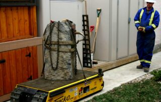 A Track O-Twin-Track 66 lifting a heavy rock